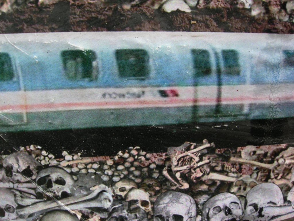 Detail - Jubilee Line desecrates Crossbones. Posters by Jimmy Cauty. Photo by Katy Nicholls