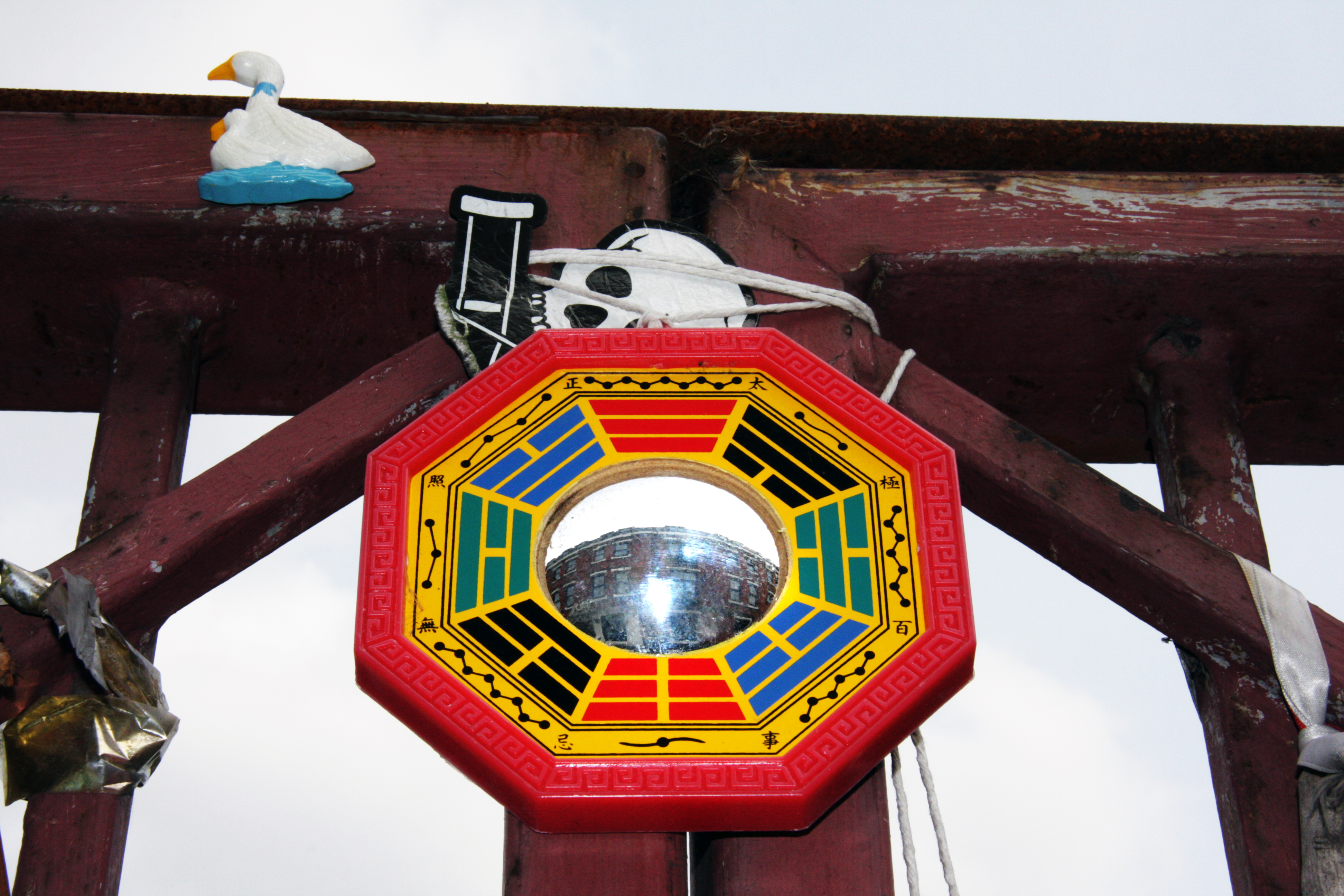 Protective Chinese mirror on the Red gates. Photo (c) Katy Nicholls
